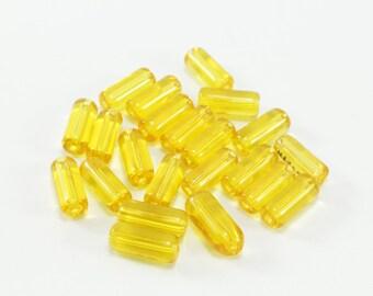 30 glass yellow 10 x 4mm Tube beads
