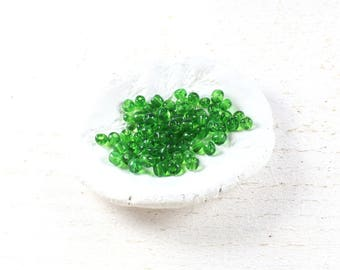 260 translucent green seed beads around 4 to 5mm LBP00549