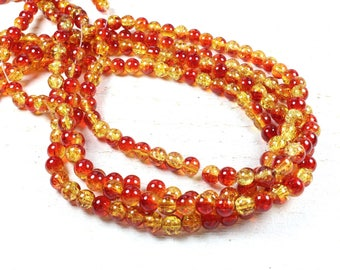 50 red & orange 6mm two-tone cracked glass beads