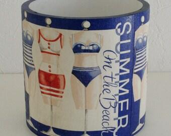 """Wooden """"Bathers"""" storage jar"""