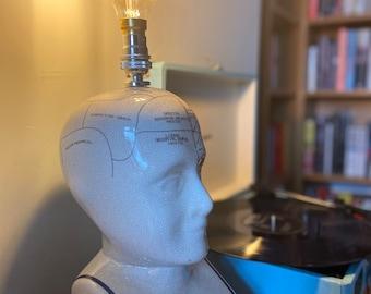 Kitsch upcycled phrenology head lamp