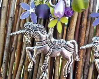 Earrings - turns pretty carousel...
