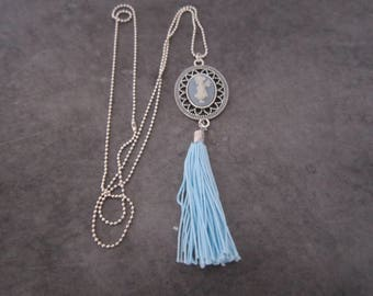 Blue cameo necklace.