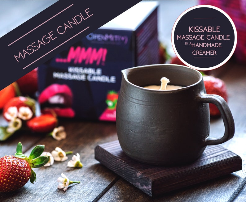 Massage candles in black pottery milk pitcher romantic image 0