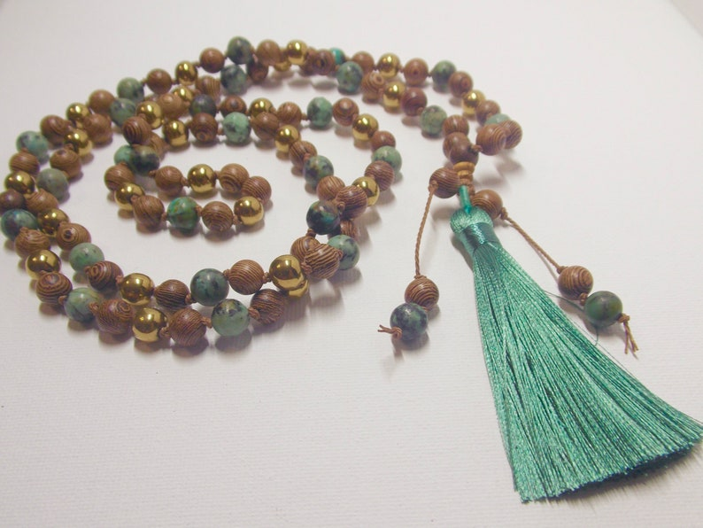 gold hematite African turquoise Wenge Wood Teal tassel African Wood and Water !