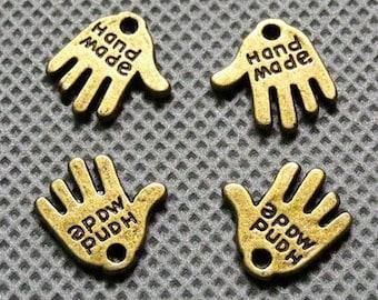 "10 handmade ""hand made"" charms, bronze, 11 x 12 mm, set of 10"