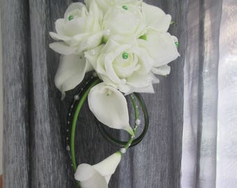 Bridal bouquet white and green roses, lilies, waterfall