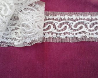 Antique white tulle embroidered band.