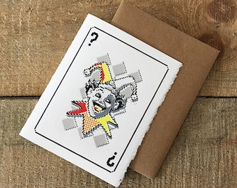screen printed pixelated joker card face greeting card