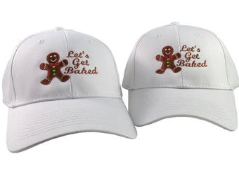 A Pair of Gingerbread Man Let's Get Baked Embroidery Designs on 2 White Adjustable Structured Baseball Caps for Adult and for Child Age 6-14