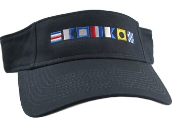 Captain Spelled Out in Nautical Flags Embroidery on an Adjustable Navy Blue Cotton Twill Visor Sun Hat