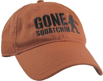 Gone Squatchin Humorous Sasquatch Bigfoot Silhouette Black Embroidery on an Adjustable Burnt Orange Unstructured Baseball Cap