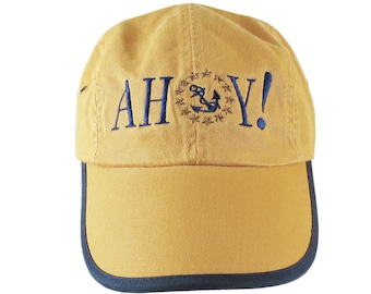 Ahoy! American Yacht Anchor Greeting Embroidery on Polo Style 5 Panel Adjustable Mango and Navy Unstructured Cap for the Boating Enthusiast