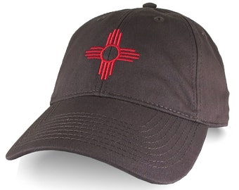New Mexico State Flag ZIA Symbol Red Embroidery Design on an Adjustable Chocolate Brown Unstructured Classic Baseball Cap Dad Hat