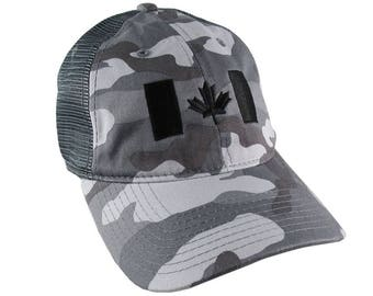 Canadian Flag Black Embroidery on a Charcoal Grey Urban Camouflage Unstructured Adjustable Classic Trucker Style Cap in Silver Back Mesh