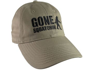 Gone Squatchin Humorous Sasquatch Bigfoot Silhouette Black Embroidery on an Adjustable Khaki Beige Unstructured Baseball Cap