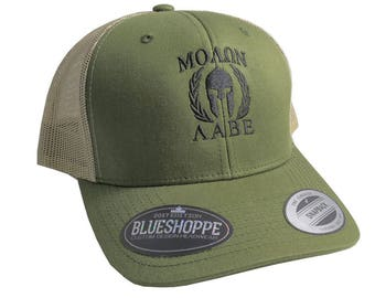 Molon Labe Spartan Warrior Mask in Laurels Black Embroidery on an Adjustable Olive Green Yupoong Structured Truckers Style Snapback Ball Cap
