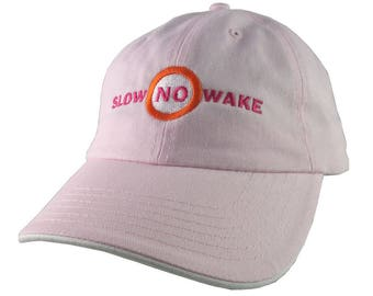 Slow No Wake Marina Nautical Warning Signage Embroidery on an Adjustable Pink and White Unstructured Baseball Cap Dad Hat Style