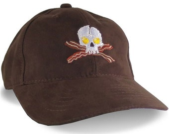 Crossbones Skull Bacon and Eggs Embroidery on an Adjustable Soft Structured Brown Ball Cap in Ultra-Suede