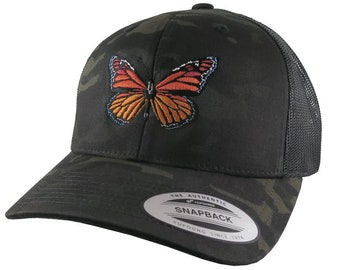 d9be73c199fe09 Monarch Butterfly Embroidery Design on an Adjustable Black Multicam  Structured Classic Yupoong Trucker Style Fashion Cap