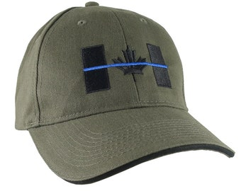 A Canadian Thin Blue Line Symbolic Black Blue Embroidery on an Adjustable Olive Green and Black Trimmed Structured Adjustable Baseball Cap