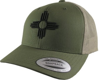 New Mexico State Flag Symbol Black 3D Puff Raised Embroidery Design on an Adjustable Olive Green Structured Classic Yupoong Trucker Cap
