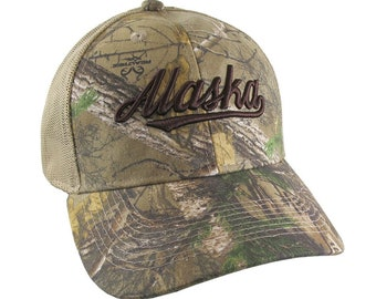 Alaska Brown 3D Puff Raised Embroidery Design on an Adjustable Realtree Camo Structured Classic Trucker Mesh Cap