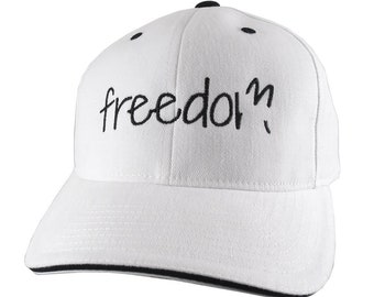 Freedom Typography Embroidery on an Adjustable White and Black Soft Structured Yupoong Baseball Cap