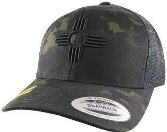New Mexico State Flag Symbol Black 3D Puff Raised Embroidery Design on an Adjustable Multicam Structured Classic Yupoong Trucker Cap