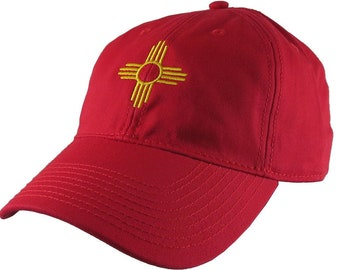 New Mexico State Flag Zia Symbol Embroidery Design on an Adjustable Red Unstructured Classic Baseball Cap Dad Hat