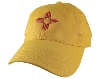 New Mexico State Flag Symbol Red Embroidery Design on an Adjustable Sun Yellow Unstructured Classic Baseball Cap Dad Hat