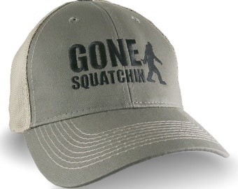Gone Squatchin Humorous Sasquatch Bigfoot Silhouette Black Embroidery on an Adjustable Olive Green and Tan Truckers Style Ball Cap