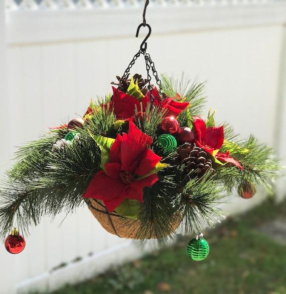 Christmas Hanging Baskets.Christmas Hanging Basket Designed With Poinsettias Pine Cones Christmas Ornaments Christmas Decor