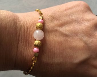 Gold metal bracelet with seed beads and and semi-precious rose Quartz bead