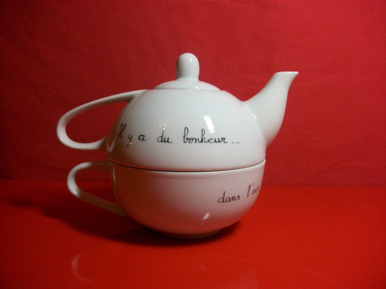 Selfish called teapot in Limoges porcelain decorated by hand with a Hedgehog on a swing