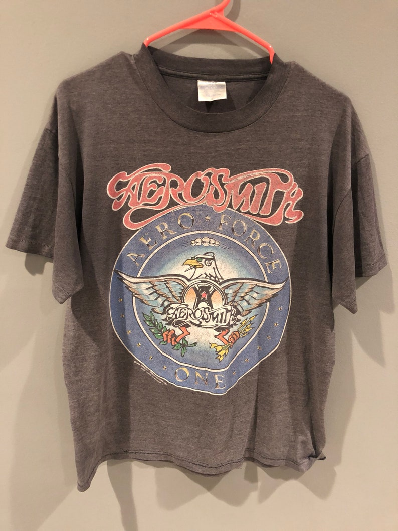 a594ca4b1 Vintage 80s Aerosmith Aero Force One band tour shirt PUMP