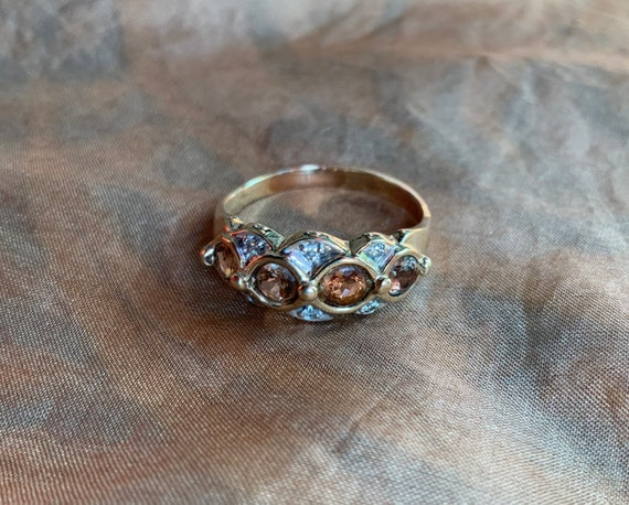 Diamond and andalusite dress ring in 9 ct gold..