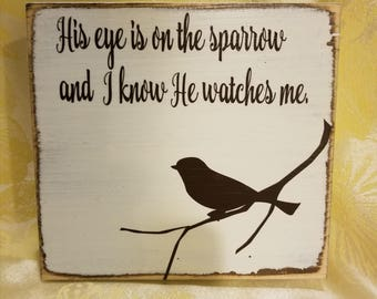His eye is on the sparrow and I know He watches me. Small wooden block.