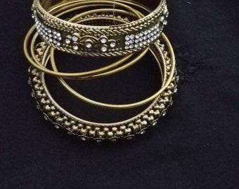 Dull gold bangles set