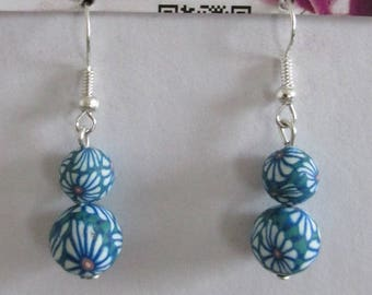 earring type two blue beads I3