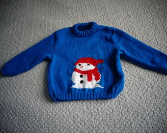blue sweater with 1 snowman white avev 1 scarf Red