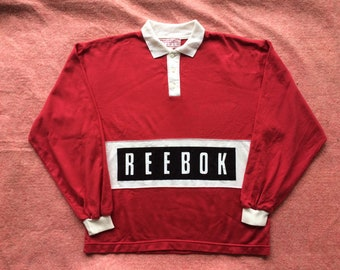 75aca1841af 90s vintage Reebok rugby shirt big spell out