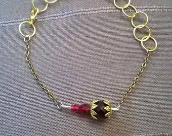 Red and black glass beaded bracelet