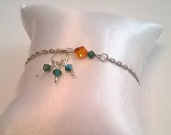 Bracelet with beads sarovski Crystal and silver chain.