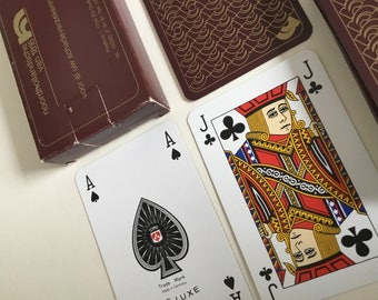 Plastic coated playing cards. Global Crossing Commercial company
