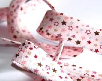 multicoloured stars through a pink background 100% cotton 18mm