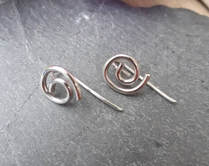 Silver earrings with swirl