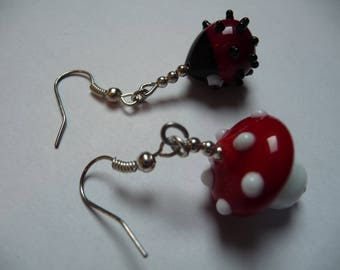Cute lampwork glass earrings, one is a mushroom and the other is a ladybird! I watched these beads being made by hand!