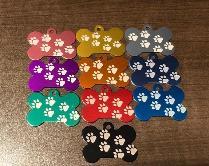 Bone shaped dog tag • Pawprint dog tag