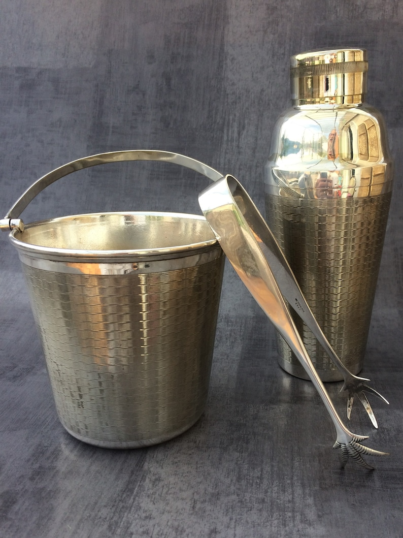 lot 150..very beautiful ENSEMBLE SEAU ice claws and SHAKER. Together bucket has ice and shaker.